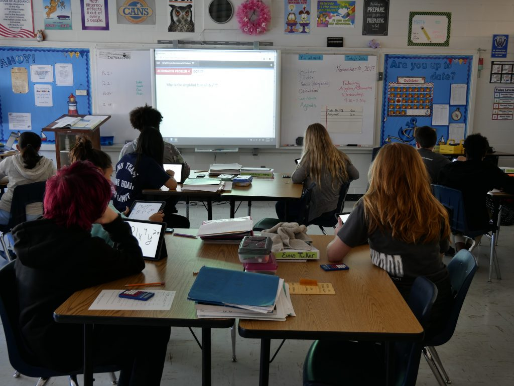 Students in math class looking at a projector screen